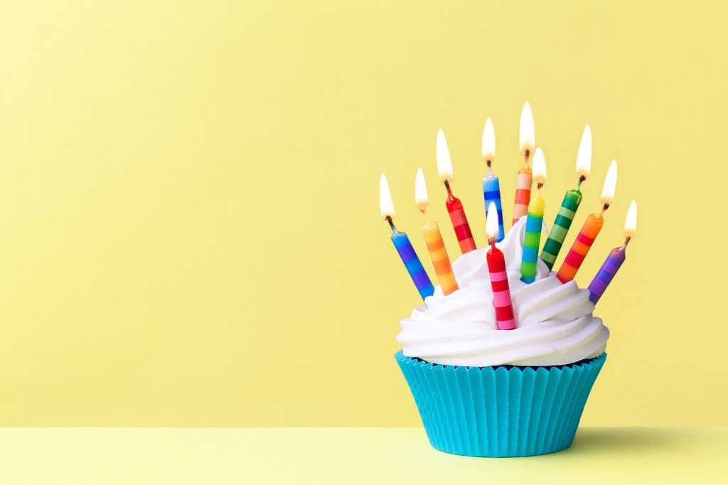 Birthday cupcake against a yellow background